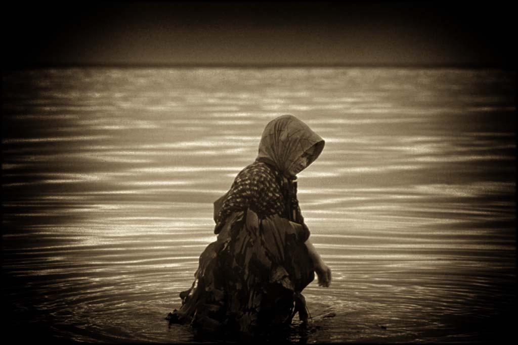 A solitary kelp picker on a gray day in Wakkanai, Japan
